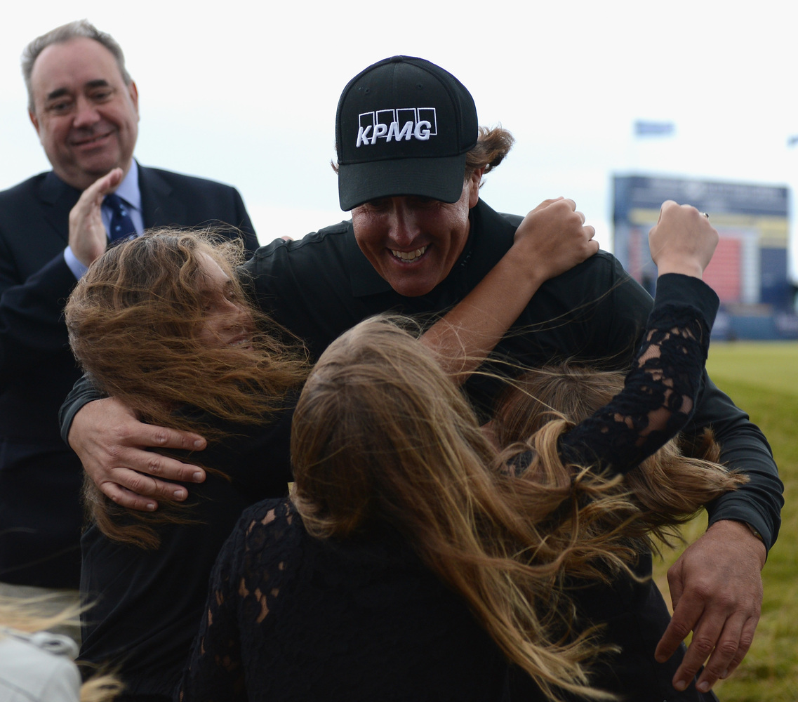 INVERNESS, SCOTLAND - JULY 14:  Phil Mickelson of the United States embraces his children Evan, Amanda (L) and Sophia after h