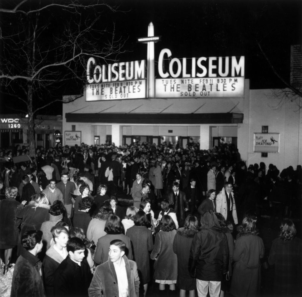 1964:  Fans outside the Coliseum, waiting for the Beatles to arrive.  (Photo by Keystone/Getty Images)