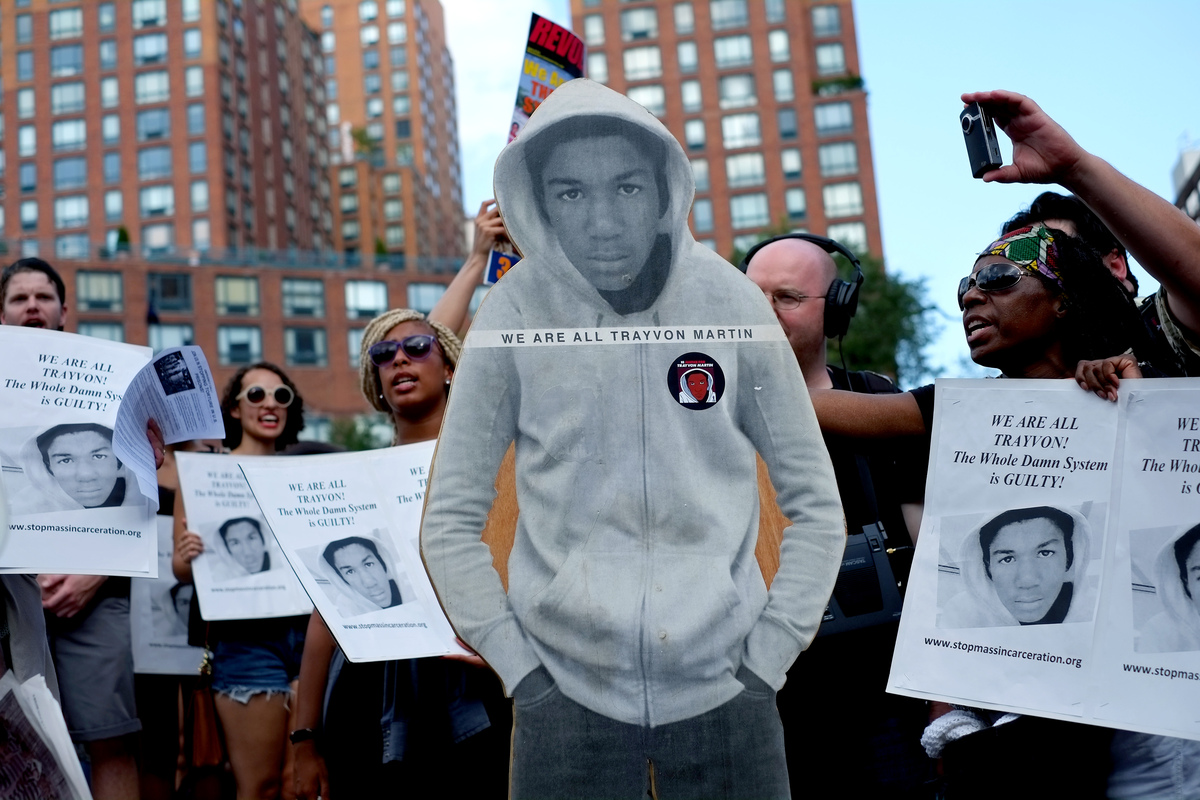 Activists on Union Square stand with a cut out photo of Trayvon Martin, Sunday, July 14, 2013, in New York, during a protest