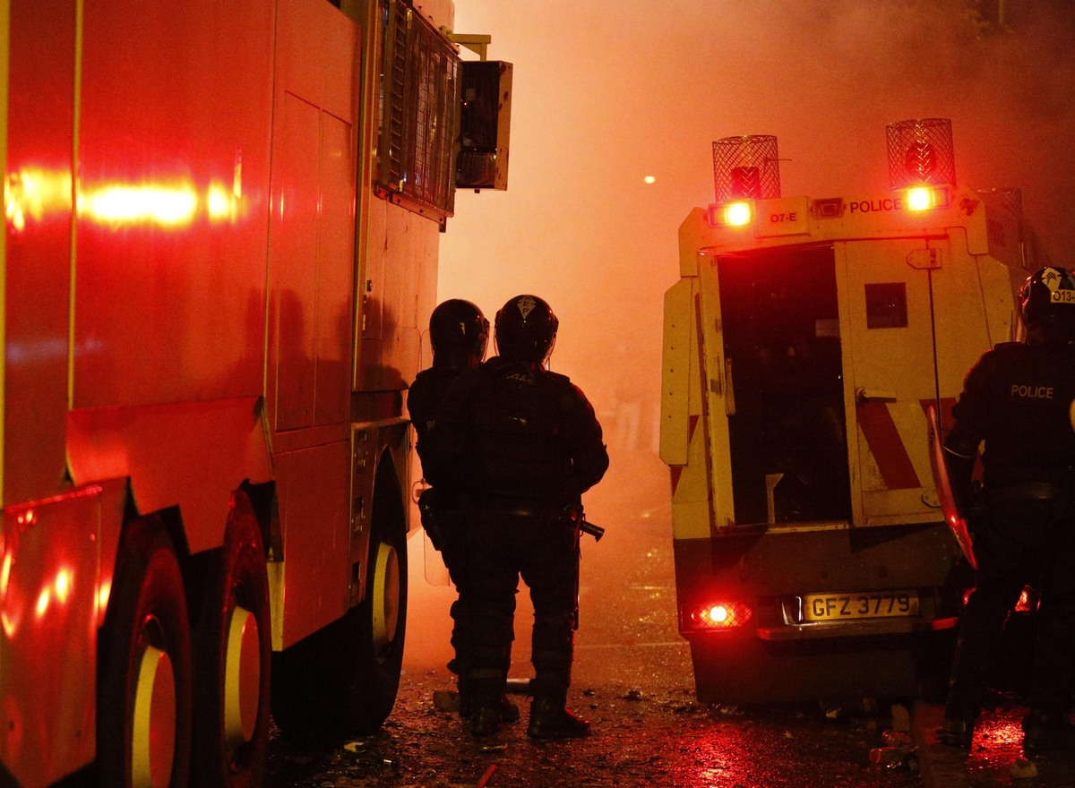 Riot police stand during rioting in North Belfast, Northern Ireland, Saturday, July 13, 2013. (AP Photo/Peter Morrison)