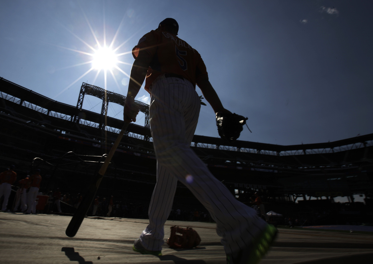 National League's Carlos Gonzalez, of the Colorado Rockies, walks to the batting cage before the MLB All-Star baseball game,