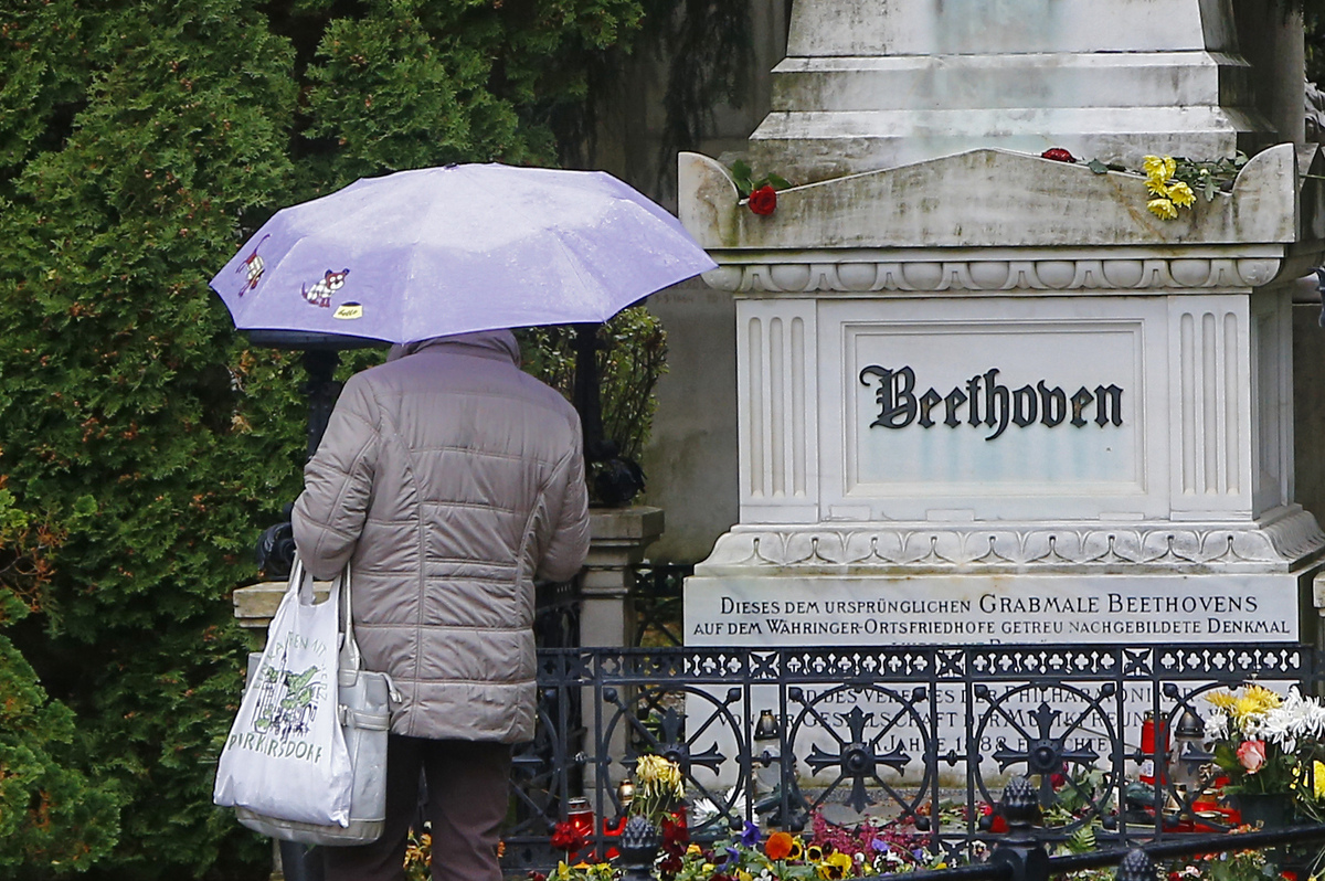 A woman pays her respect in front of the tombstone of German composer Ludwig van Beethoven at the central cemetery (Zentralfr