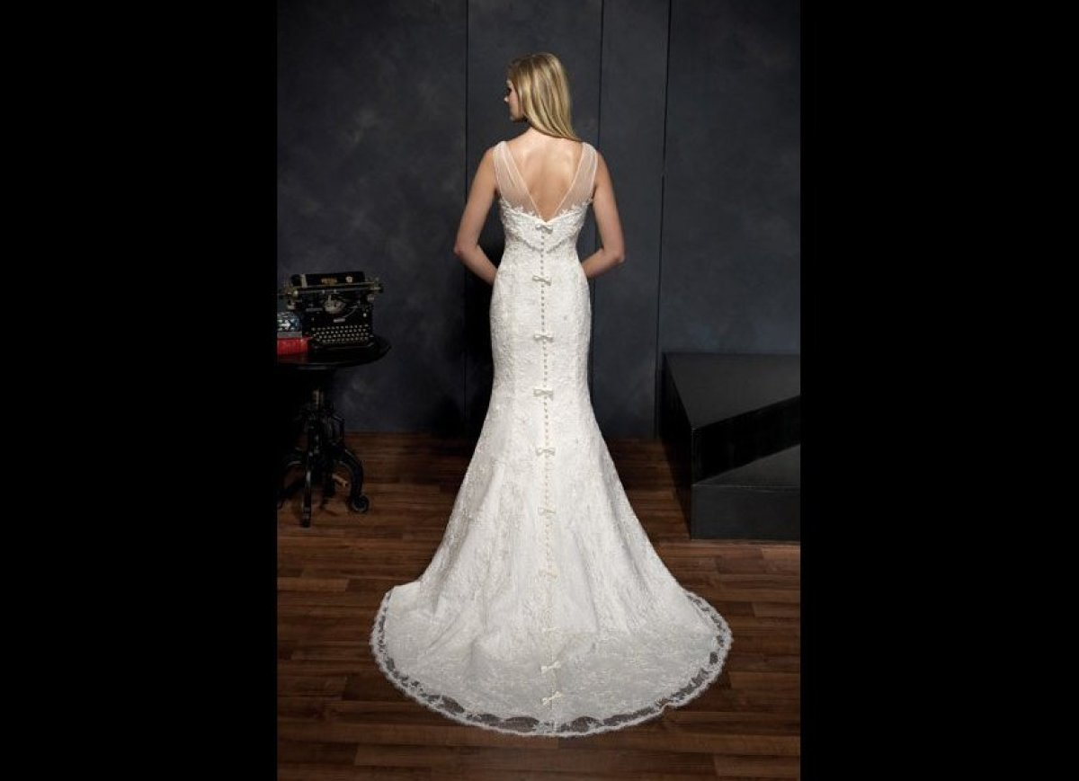 """Sweet bows add a youthful touch to this classic<a href=""""http://plbgbridal.com/product/kenneth_winston"""" target=""""_hplink""""><str"""