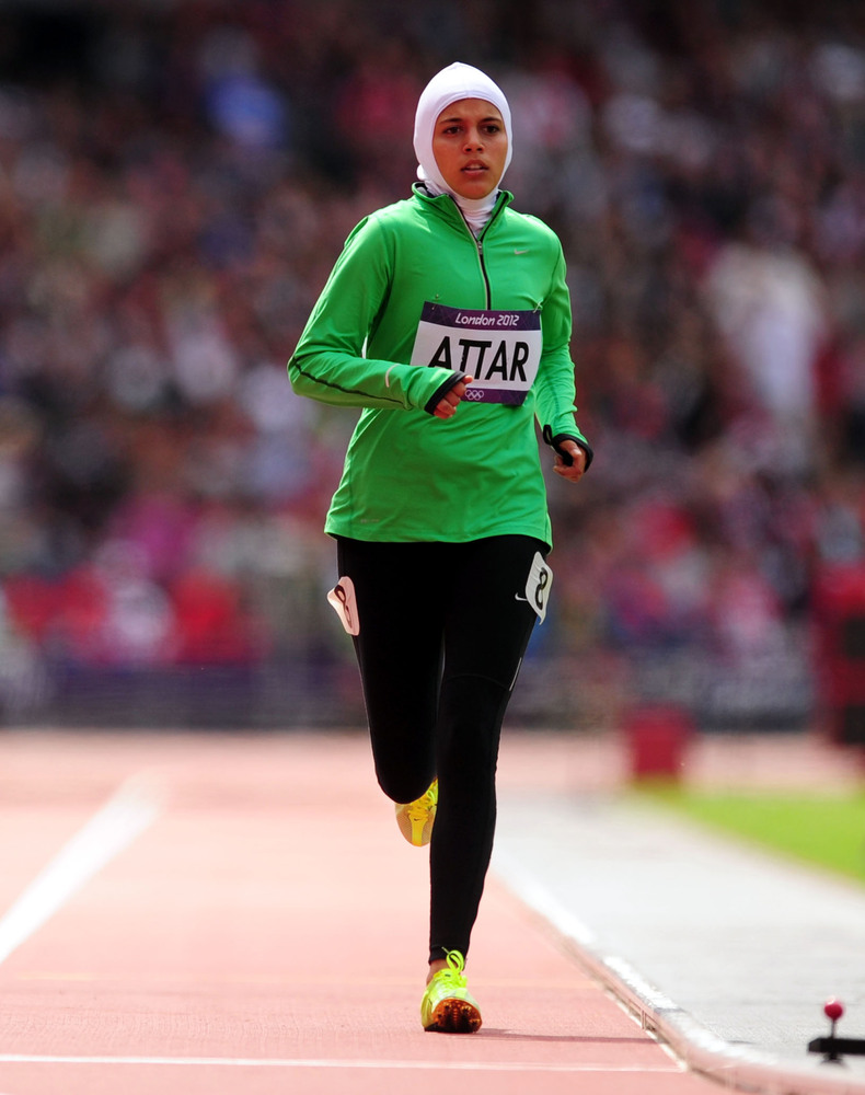 Her position in the women's 800m heats may have been a distant last but it was a 'first' that prompted a standing ovation fro