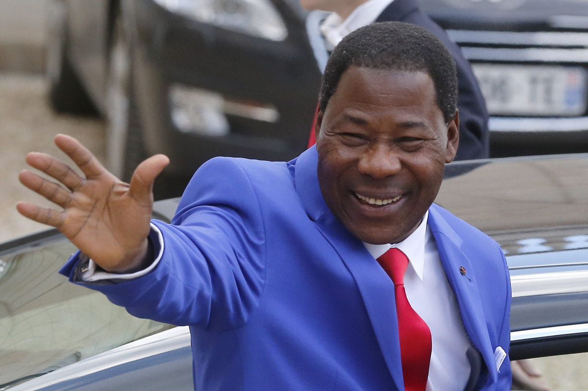 President of Benin Thomas Boni Yayi, waves to the media after a meeting with France's President Francois Hollande at the Elys