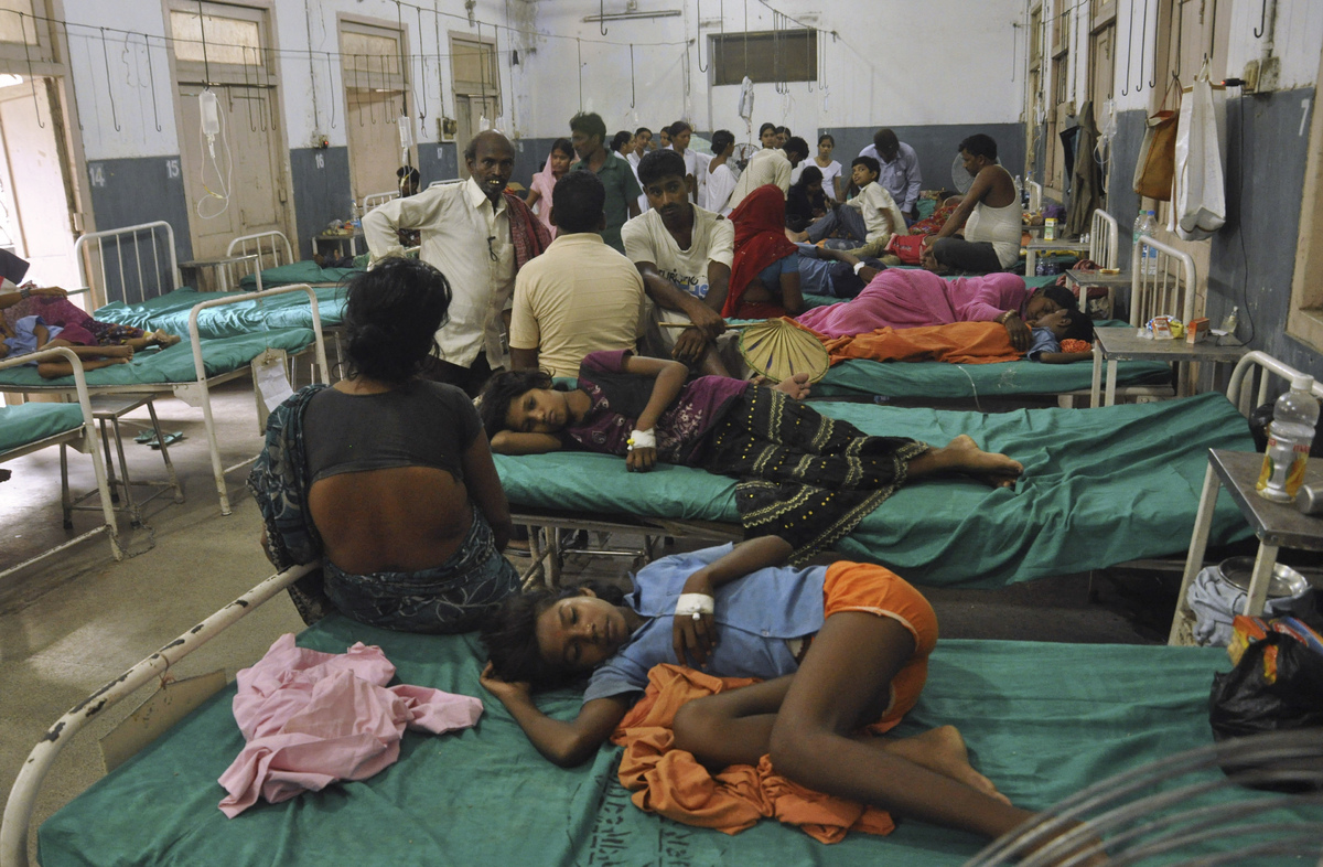Indian children who fell sick after eating a free school lunch lie at a hospital in Patna, India, Wednesday, July 17, 2013. (