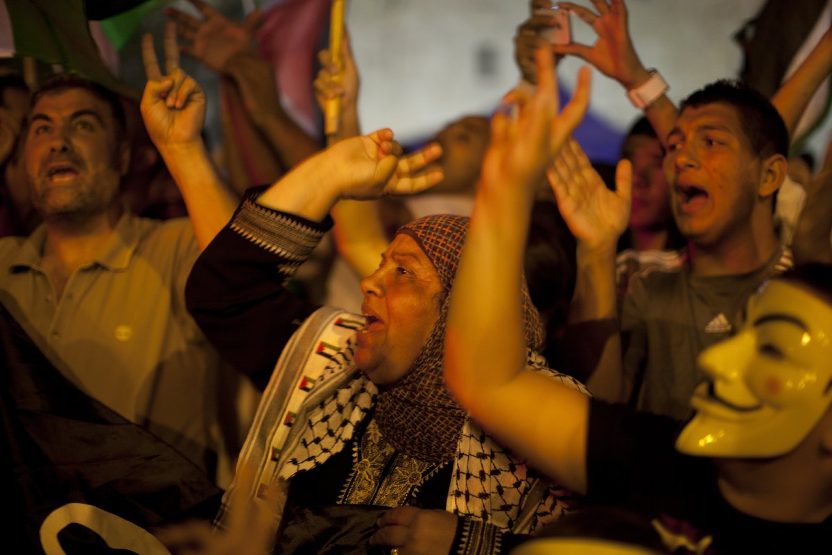 Palestinian protesters shout slogans on July 15, 2013 during a demonstration against Israeli government's plans to relocate B