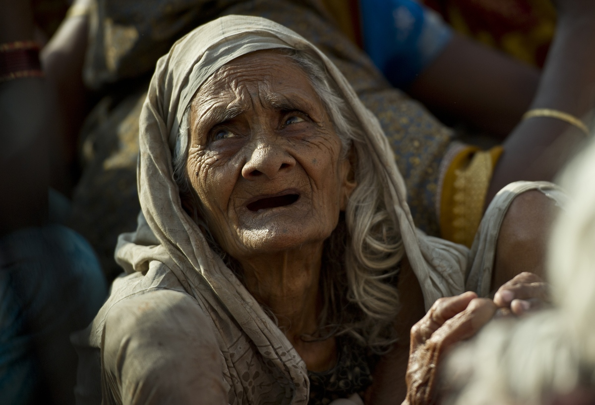 Indian widows attend a prayer meeting organised by NGO Sulabh International on the banks of Ganges river in Varanasi on April