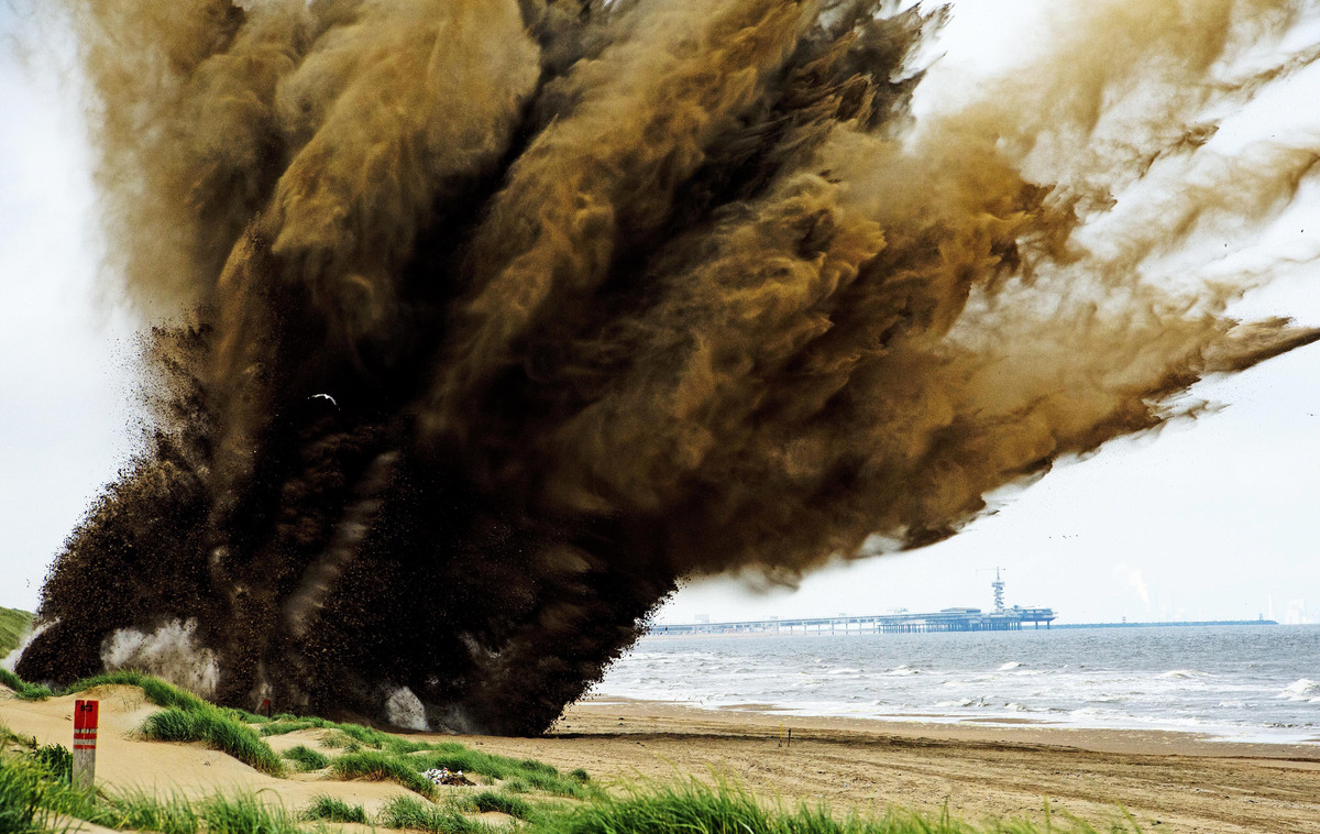 A 500-pound bomb from World War II is detonated in a controlled explosion on the beach in Wannenaar on July 13, 2013. The bom