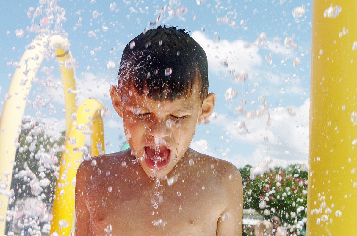 Kevin Guardiola cools down Saturday, July 20, 2013 at the Pepsi Splash Pad at Fairfield Park in Kinston, N.C. (AP Photo/ The