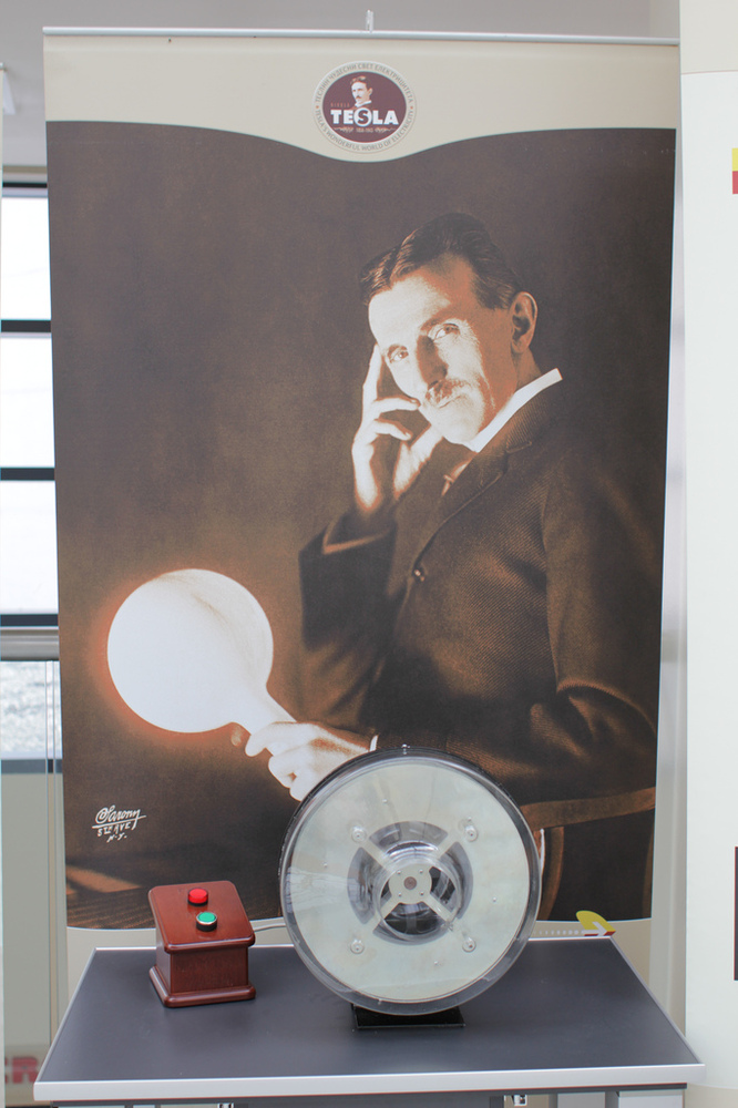 A picture of Nikola Tesla holding a light bulb. Tesla's rival Thomas Edison invented the modern light bulb, but it was Tesla