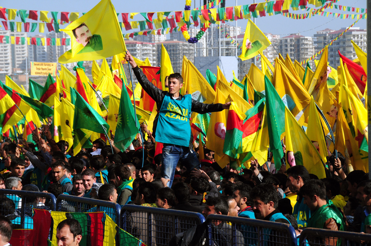 A Kurdish man waves a poster of founder of PKK (Kurdish Worker Party) Abdullah Ocalan during celebrations of Nowruz, the Pers