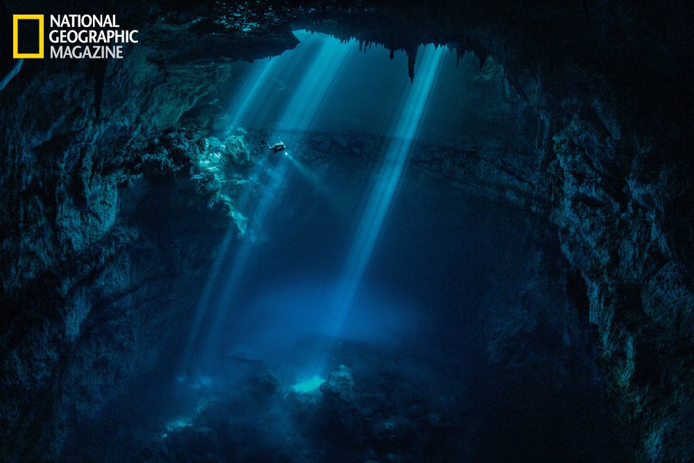 A diver explores a cenote near the Maya ruins of Tulum. (Paul Nicklen/National Geographic)  http://ngm.nationalgeographic.com