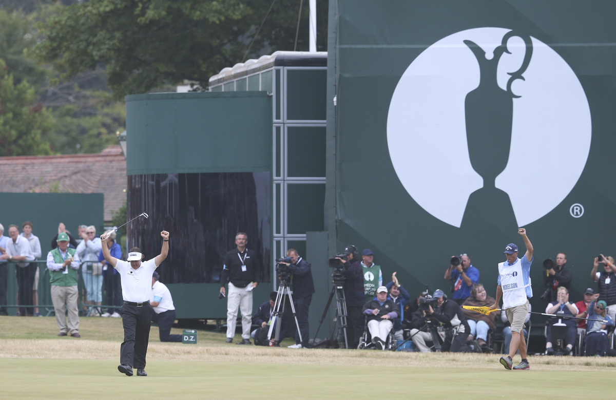 Phil Mickelson of the United States celebrates after his final putt on the 18th green during the final round of the British O