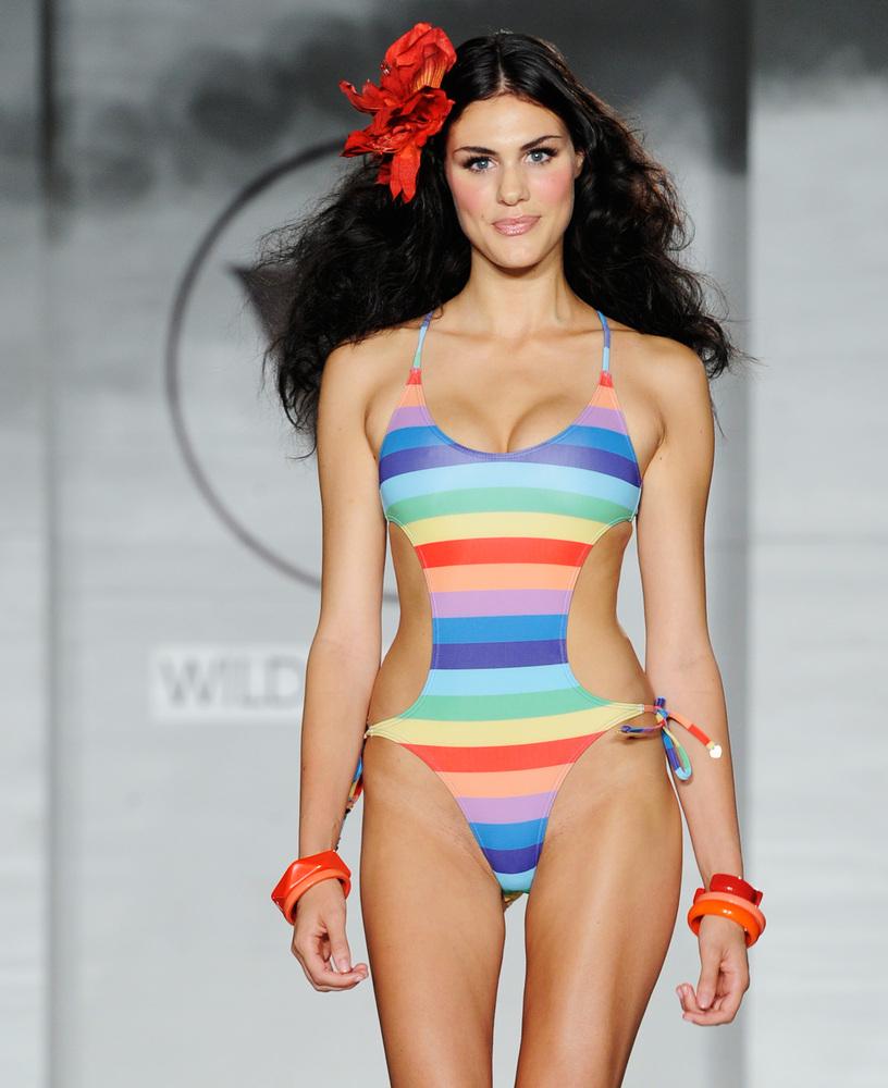 MIAMI BEACH, FL - JULY 21:  A model walks the runway at the Wildfox Swim Cruise 2014 show at Soho Beach House on July 21, 201