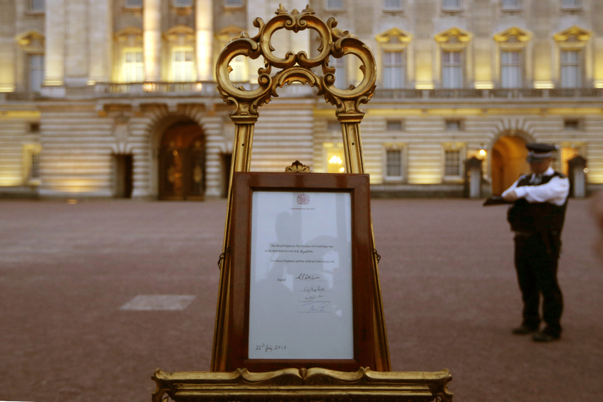 A notice proclaiming the birth of a baby boy of Prince William and Kate, Duchess of Cambridge is display for the public view