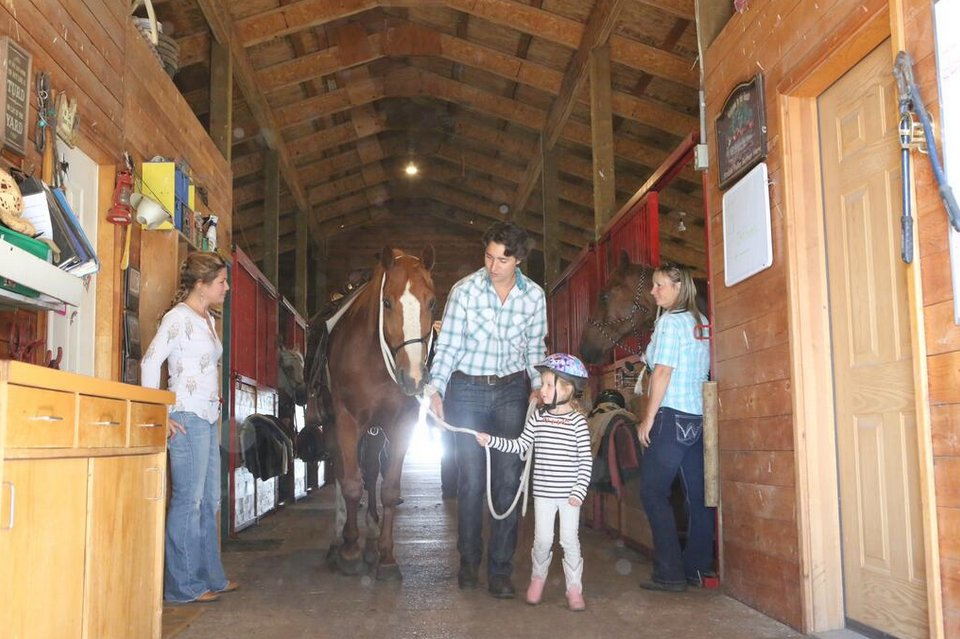 Liberal Leader Justin Trudeau saddles up a horse in a Kamloops, B.C. stable.