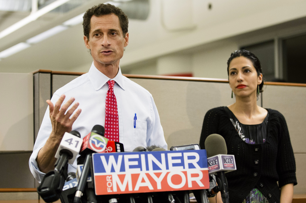 New York mayoral candidate Anthony Weiner speaks during a news conference alongside his wife Huma Abedin at the Gay Men's Hea