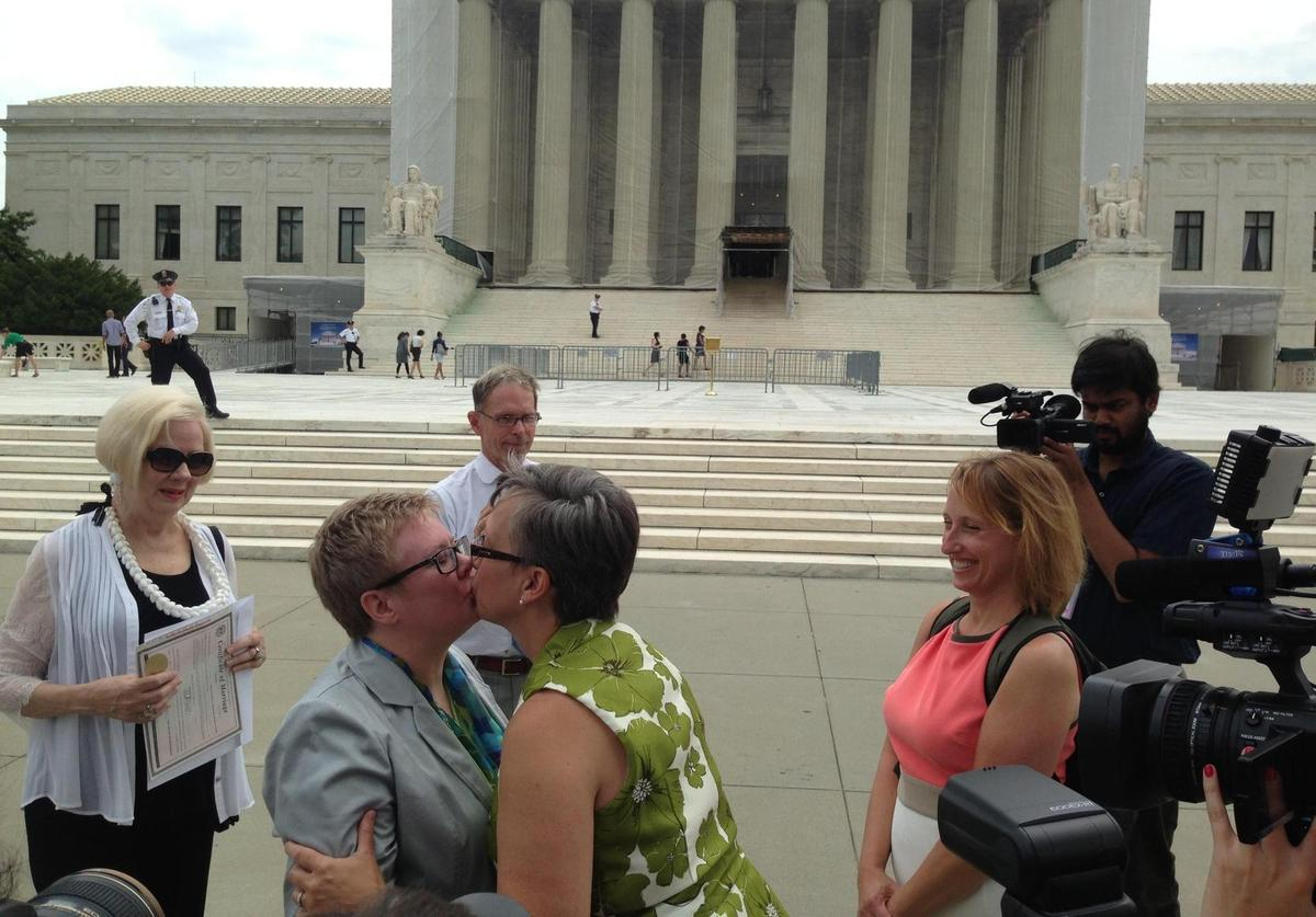 Libby Emlow and Amanda Adams, who have been together for 21 years, kiss following the ceremony.