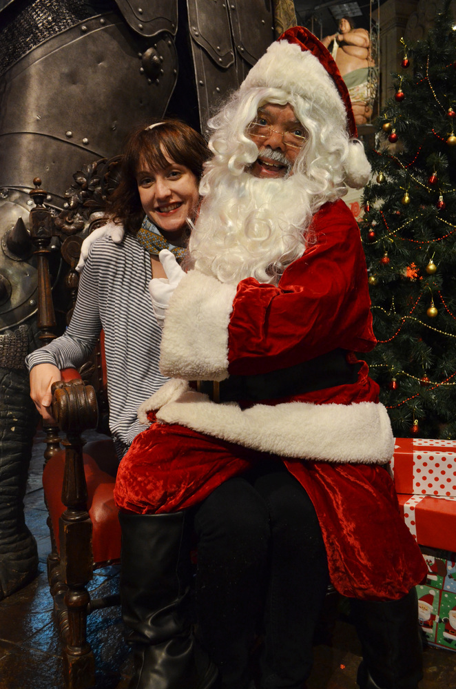 Weird News Editor Hilary Hanson underneath dwarf Santa.