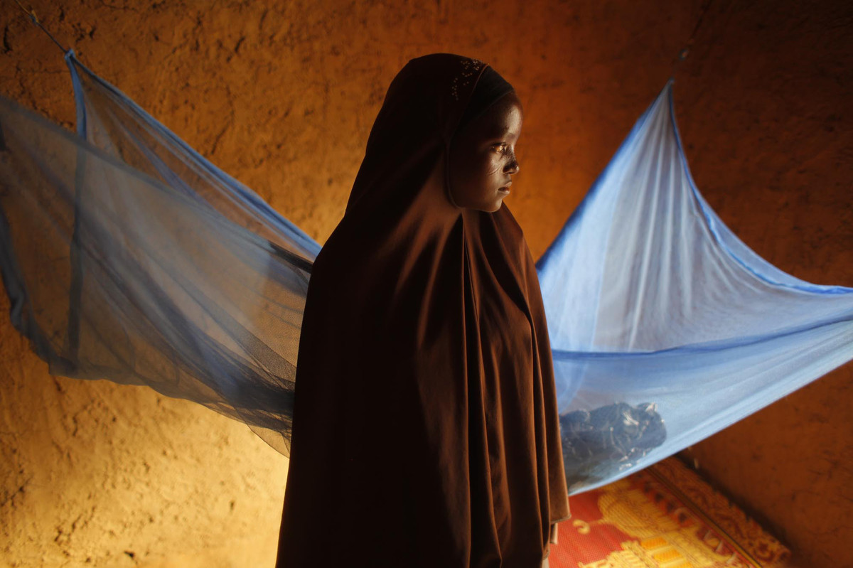 In this picture taken Wednesday, July 18, 2012, Zali Idy, 12, poses in her bedroom in the remote village of Hawkantaki, Niger