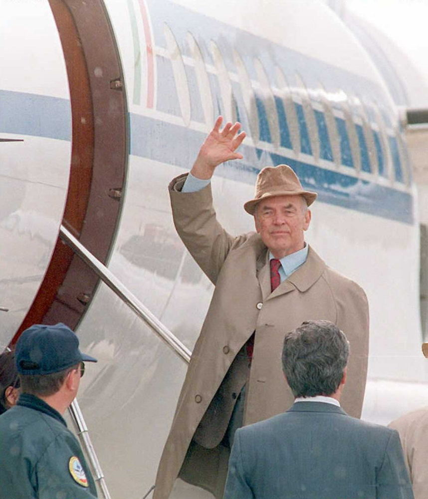Former Nazi SS captain Erich Priebke waves goodbye as he enters an airplane at the Bariloche Airport,Argentina,bound for Ital