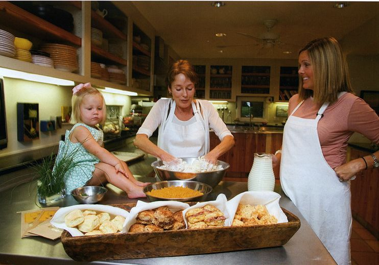 In the beginning, Carrie baking biscuits with her mom and daughter.