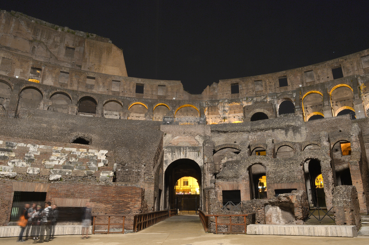 This picture shows visitors inside of the Colosseum during a preview of the night tour 'The moon over the colosseum' late on