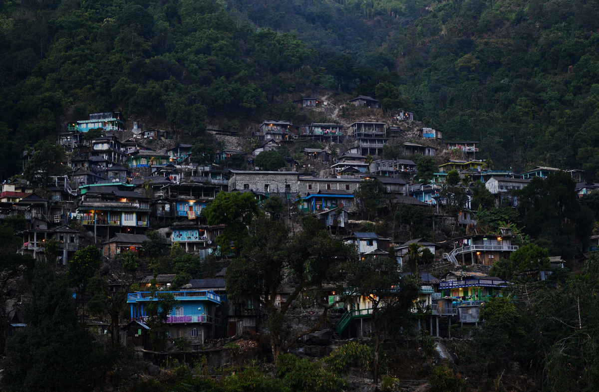 In this photograph taken on February 3, 2013, some homes appear with their lights on in the early evening in a village, part