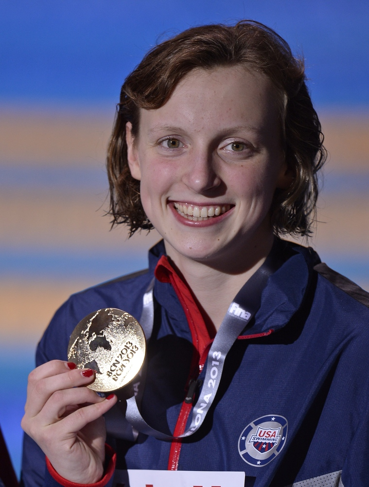 Katie Ledecky of the United States smiles as she holds her gold medal during the presentation ceremony for the Women's 1500m