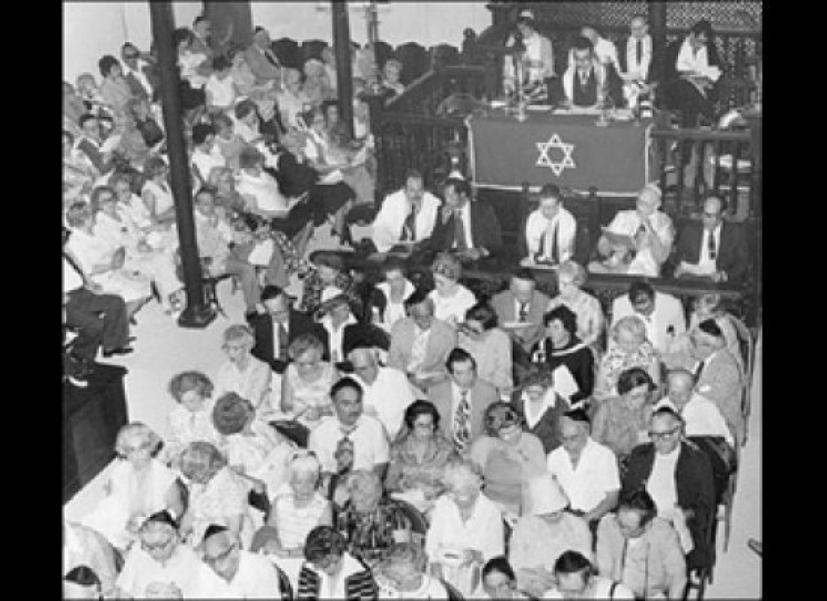 Shaare Shalom Synagogue congregants pray together in the 1950s.