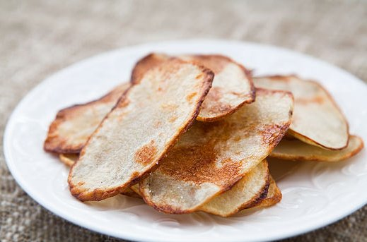 """<strong>Try the <a href=""""http://www.simplyrecipes.com/recipes/oven-fried_potato_chips/"""" target=""""_blank"""">Oven-Fried Potato Chi"""