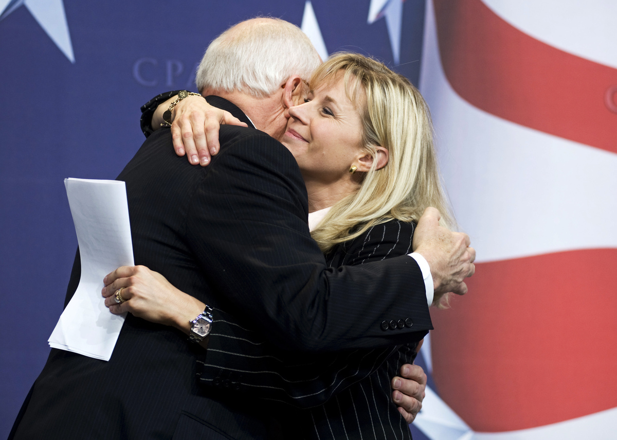 FILE - This Feb. 18, 2010 file photo shows Former Vice President Dick Cheney hugs his daughter, Liz Cheney, at the Conservati