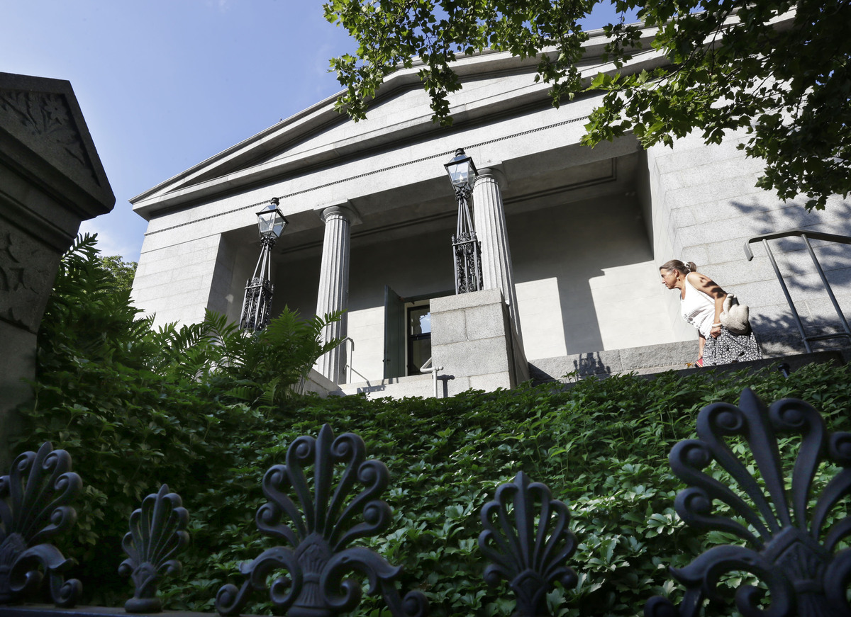 A woman enters the Providence Athenaeum, in Providence, R.I., Monday, July 15, 2013. With roots dating back to 1753, the priv
