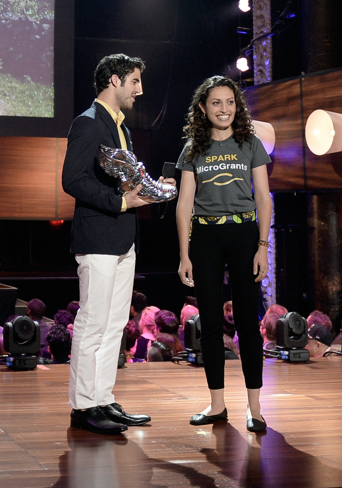 HOLLYWOOD, CA - JULY 31:  Actor Darren Criss (L) presents award to Sasha Fisher of SPARK MicroGrants onstage at the DoSomethi