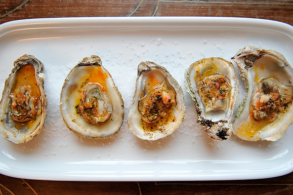 """<strong>Get the <a href=""""http://food52.com/recipes/2882-grilled-or-broiled-oysters-with-a-sriracha-lime-butter"""" target=""""_blan"""