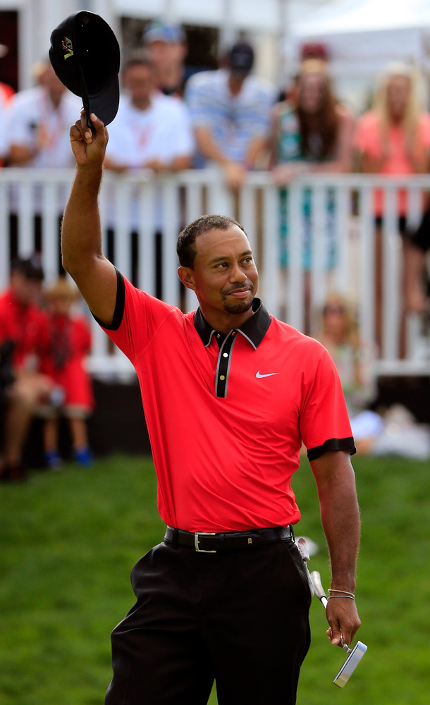 AKRON, OH - AUGUST 04: Tiger Woods waves to the crowd on the 18th green after winning the World Golf Championships-Bridgeston