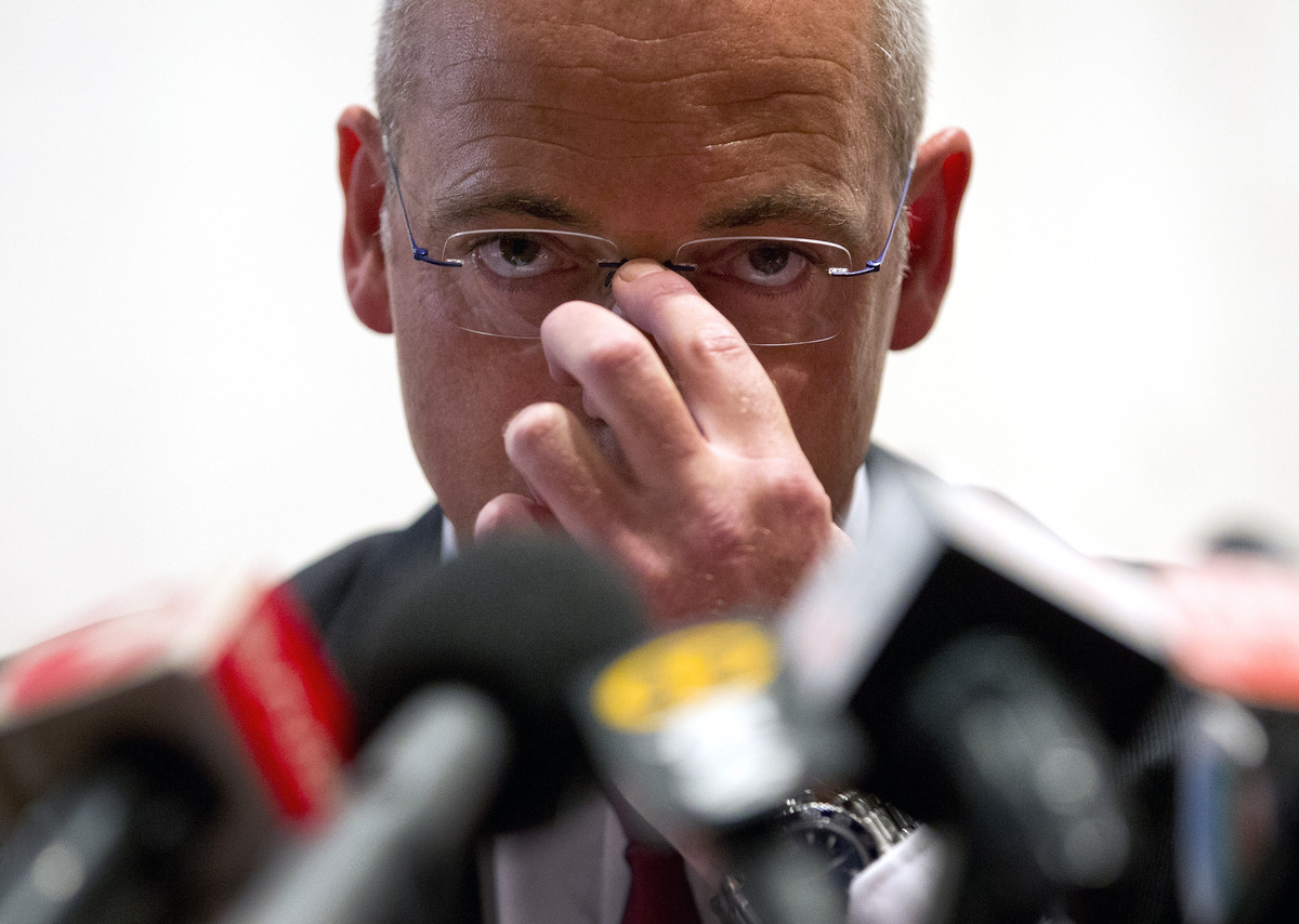 New Zealand dairy giant Fonterra Chief Executive Officer Theo Spierings adjusts his glasses upon arrival for a press conferen