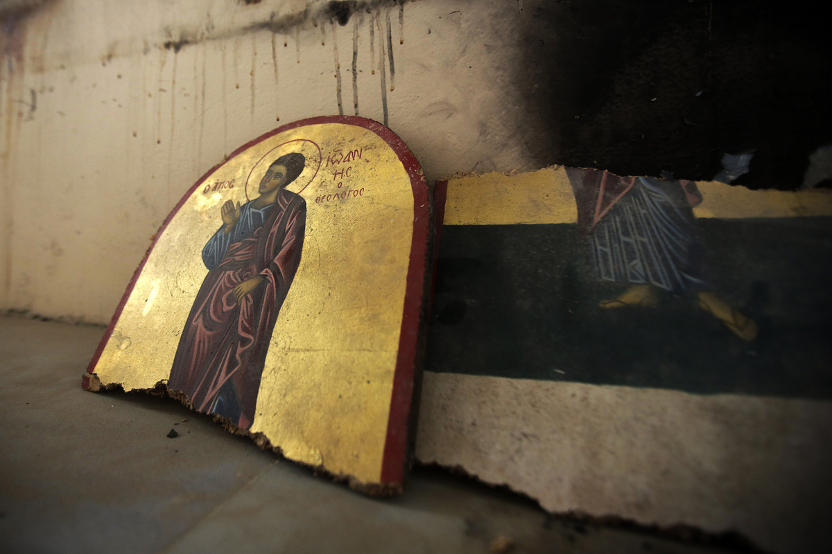 A picture taken on August 1, 2013 shows pieces of a desecrated icon at Saint Elie Church in the city of Qusayr, in Syria's ce