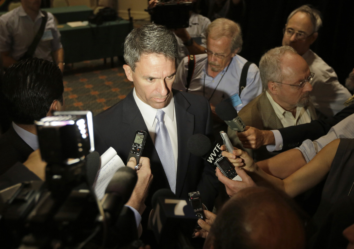 Republican gubernatorial candidate, Virginia Attorney General, Ken Cuccinelli, center, answers questions from the media after