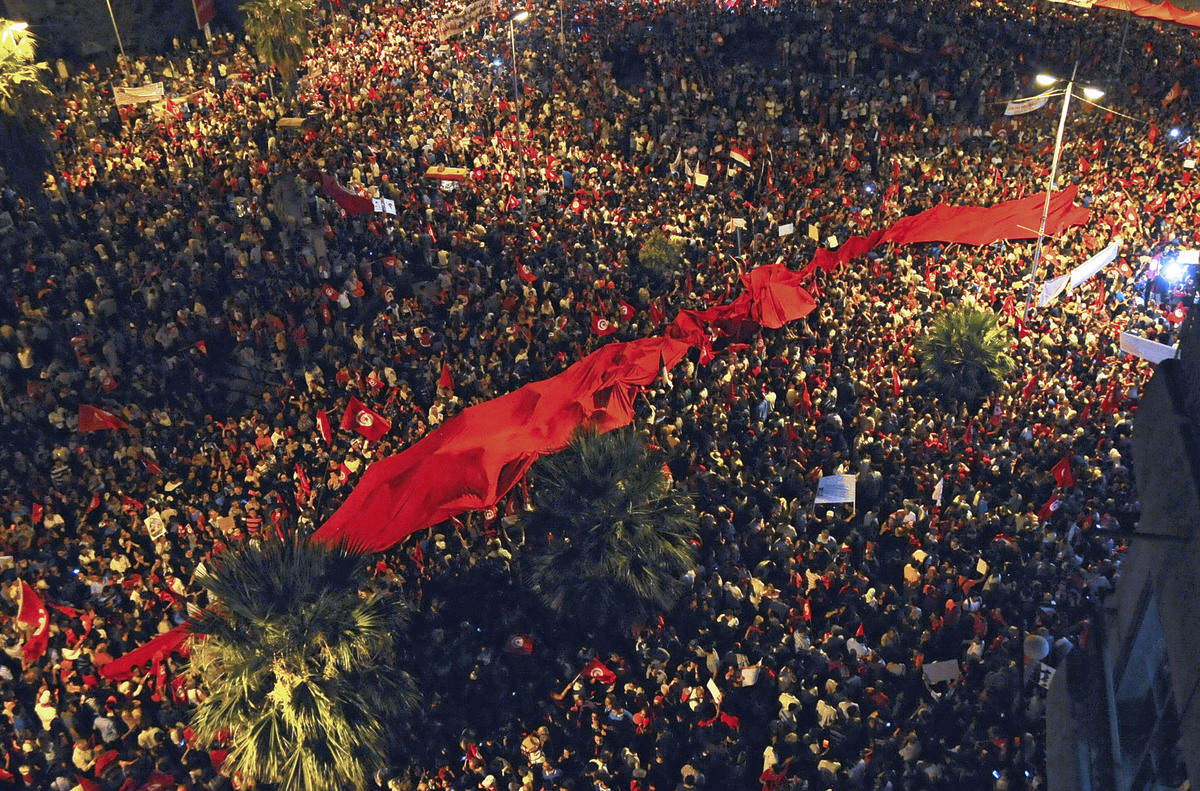 People demonstrate against Tunisia's Islamist-led government, Tuesday Aug. 6, 2013 in Tunis. (AP Photo/Hassene Dridi)