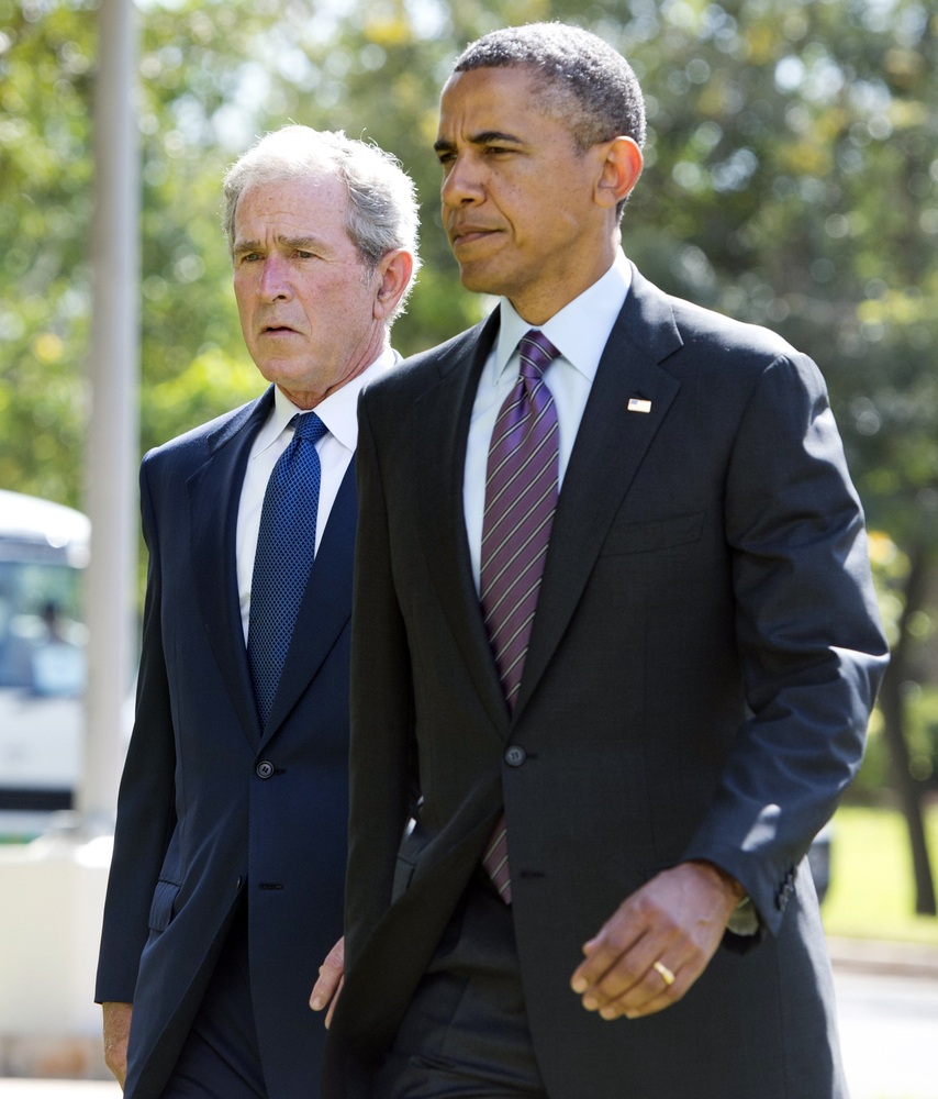 U.S. President Barack Obama and former U.S. President George W. Bush arrive on July 2, 2013 for a wreath-laying ceremony for
