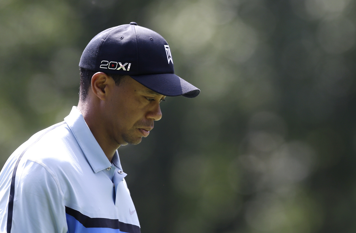 Tiger Woods looks down after a bogie on the fourth hole during the first round of the PGA Championship golf tournament at Oak