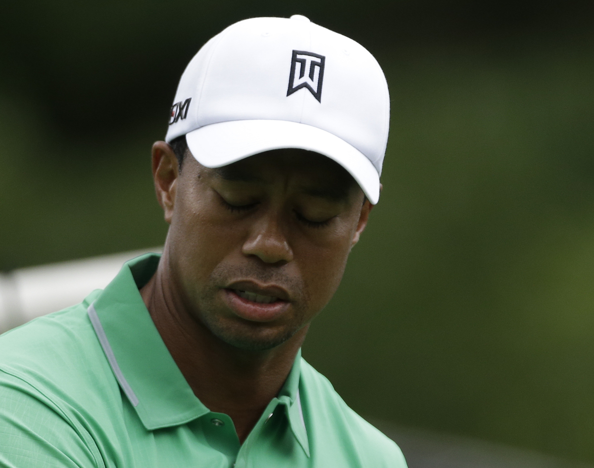 Tiger Woods reacts after driving a ball into the rough on the second hole during the second round of the PGA Championship gol
