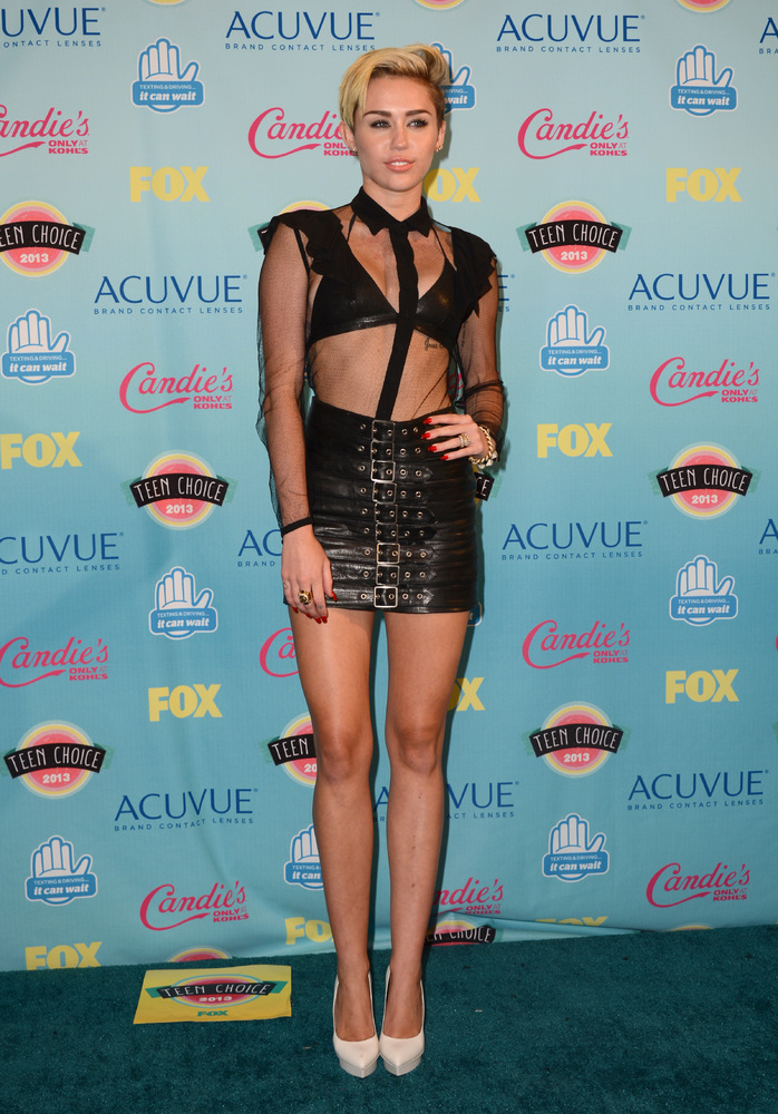 Miley Cyrus poses backstage at the Teen Choice Awards at the Gibson Amphitheater on Sunday, Aug. 11, 2013, in Los Angeles. (P