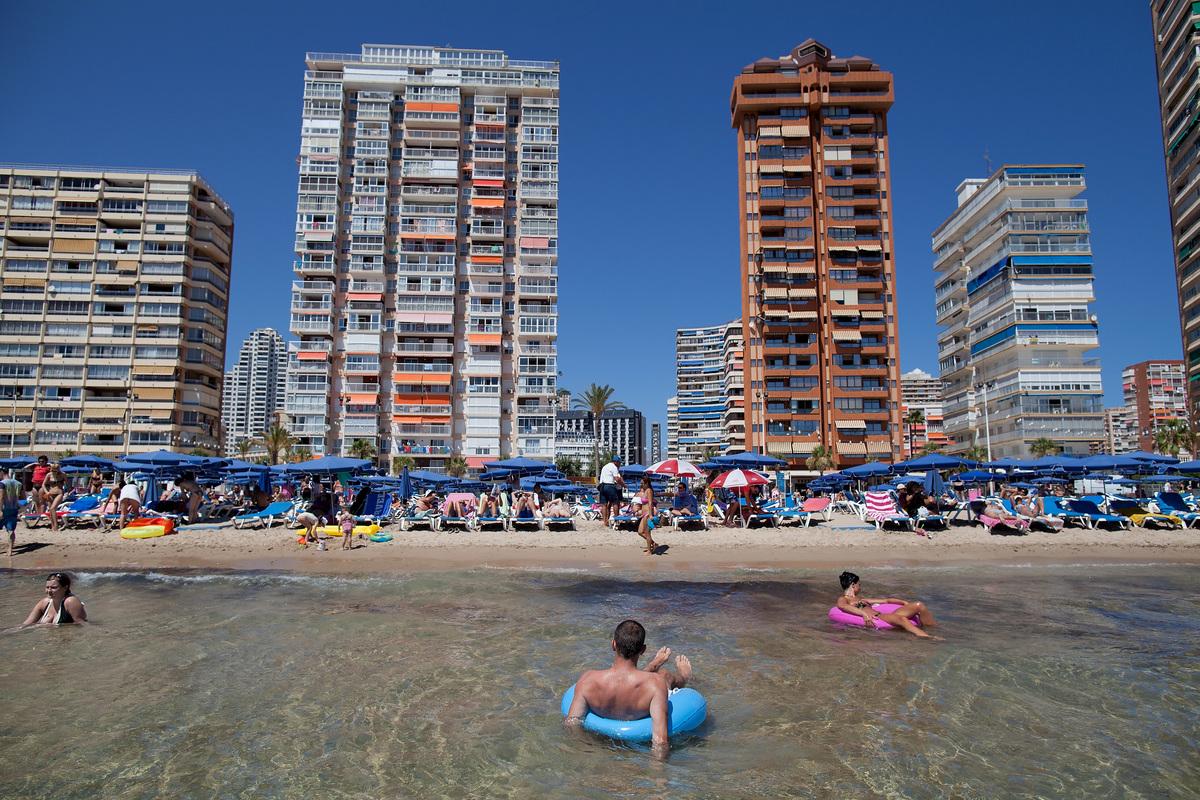 People enjoy the weather on Levante Beach on August 10, 2013 in Benidorm, Spain. Benidorm is one of Europe's top package holi