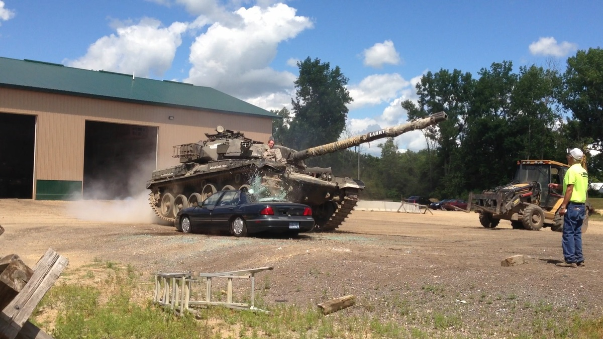 David Lohr's son Alex crushing a car at Drive A Tank in Kasota, Minnesota.
