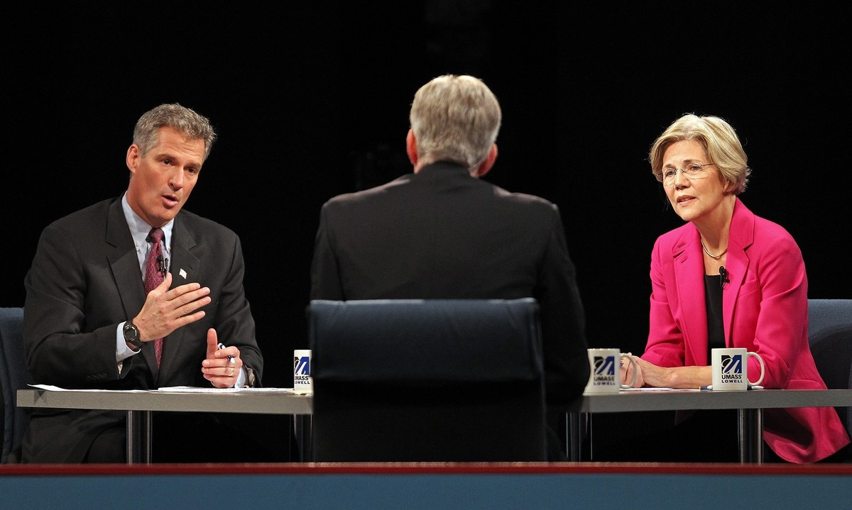 Republican U.S. Sen. Scott Brown, left, gestures as he answers a question during a debate against Democratic challenger Eliza