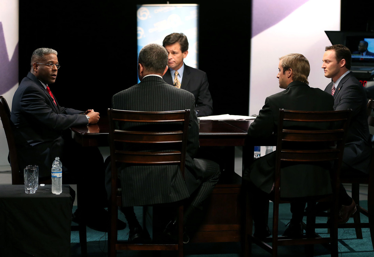 Congressional candidates Allen West, left, and Patrick Murphy, right, participate in a debate moderated by Michael Williams o