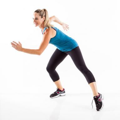 A. Stand with feet wider than hip-width apart. Bend right knee into a side lunge, extending left leg and pointing left foot,